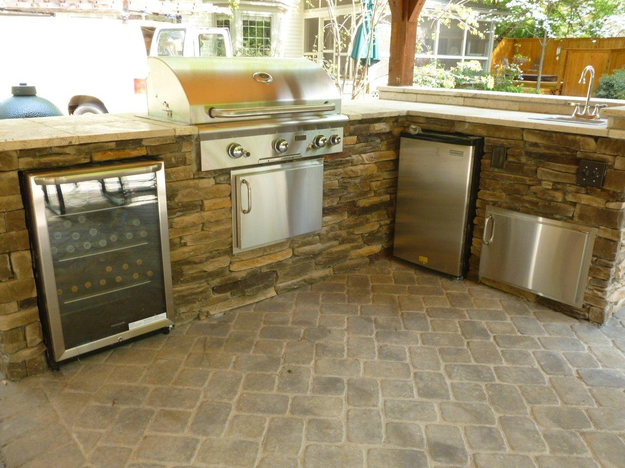 outdoor-kitchen-with-wine-refrigerator-grill-and-travertine-counter-top - Copy